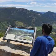 Two people overlook scenery at Rocky Mountain National Park