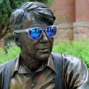 Robert Frost statue wearing sunglasses