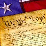 Image of the U.S. constitution and American flag