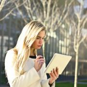 Young professional reading on tablet