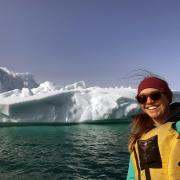 Sarah Crump poses in front of an Arctic glacier