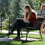 A student studies in front of Baker Residence Hall at the University of Colorado Boulder. (Photo by Casey A. Cass/University of Colorado)