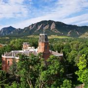 Old Main building with the Flatirons in the background.
