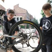 Max Robbins, a senior environmental science major from Grand Junction (left) and Thrombin Atwell-Donaghey, a sophomore chemistry major from Boulder tune a bike at the UMC bike station at the University of Colorado Boulder. (Photo by Casey A. Cass/University of Colorado)