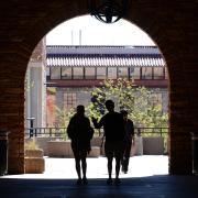 Students walking through UMC arch