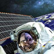 Illustration of astronaut, space station, green grass and trees, solar panels