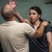 Instructor teaches student self-defense skills