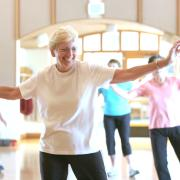 Senior woman exercising in group class