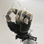 A prosthetic hand with fingertip sensors installed.