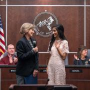 CU Boulder journalism and political science undergraduate student and Rhodes Scholar Serene Singh, right, listens as  Boulder Mayor Suzanne Jones reads a special proclamation honoring her at the Boulder City Council chambers on December 4, 2018 before their regular weekly meeting.  (Photo by Glenn Asakawa/University of Colorado)