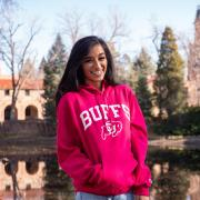 Serene Singh in front of Varsity Lake on campus