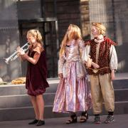 Children perform Shakespeare in costume on stage