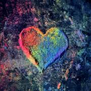 Sand art of a multicolored heart