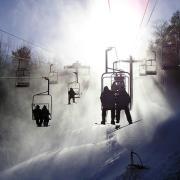 Ski lift takes snow skiers up the mountain