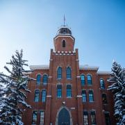 The Old Main building with a dusting of snow