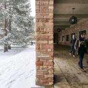 Students walking across snowy campus