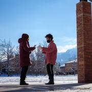 students practicing a play near Farrand Field