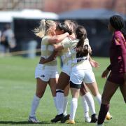 CU women's soccer celebrating against Arizona State