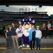 CU Boulder first-place international solar decathlon team members pose with U.S. Secretary of Energy Jennifer Granholm, second from right, and Colorado Rockies mascot Dinger during a game against the St. Louis Cardinals on July 1. The team was hosted and recognized by the secretary during her visit to Denver. (Photo courtesy of the Colorado Rockies)