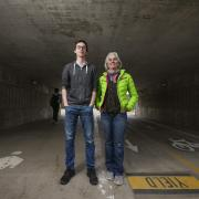 Instructor Martha Russo and student Sam Jones pose for a photo in the Regent underpass