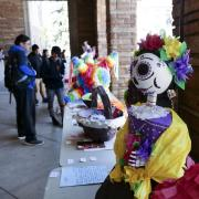 Students look at Spanish Heritage Language and Culture Day displays on campus