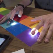 app-connected rings that users wear on their fingers that turn color into sound