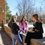 Students chat on campus