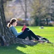 Girl reads book on campus
