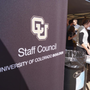 A Staff Council sign at an outdoor event.