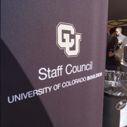 A Staff Council banner is on display at an employee fair outdoors.