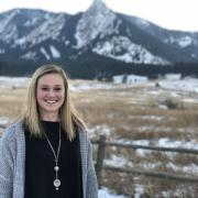Integrated physiology major Kelsey Sheehan poses in front of Flatirons