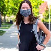 Student wearing a mask on campus