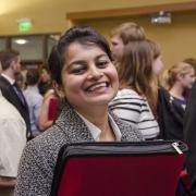 Student smiles for a photo at a campus career fair