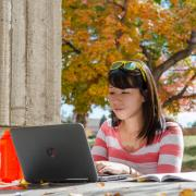 Student working at computer on campus