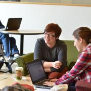 Students work together to study at a lounge on campus
