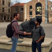 Student veterans shaking hands