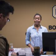 Student-employee works at front desk