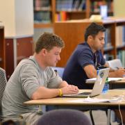 Students on laptops at Norlin Library