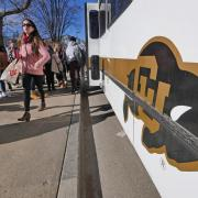 People step off the Buff Bus on the first day back from winter break. Photo by Casey A. Cass.