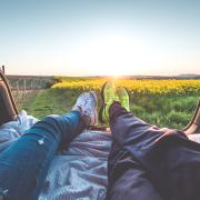 two people sitting with view of yellow flowers