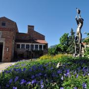 Statue, indigo flowers outside the UMC
