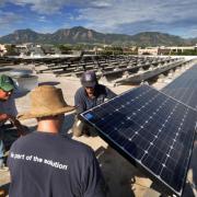 CU staff members install solar panels on campus