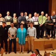 The campus sustainability award winners stand shoulder to shoulder.