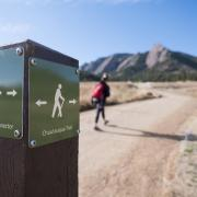 Person hiking Chataqua Trail near Flatirons