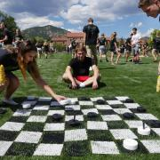 Students play life-size game of checkers at Taste of CU event