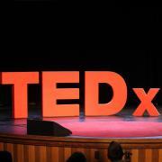 TEDxCU sign on stage