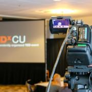 Video camera pointed at TEDxCU screen