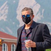 Man wearing two masks