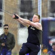 Caleb Penner competing in field event