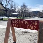 sign that reads 'essential car traffic only'